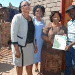 The Mayor of //Khara Hais, Me Limakatso Koloi, left, during the handing over of a house to one of the beneficiaries.