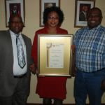 In the picture with the award is from left to right, the Speaker of //Khara Hais Municipality, Mr Thomas Basson, the Mayor of //Khara Hais Me Limakatso Koloi and the Municipal Manager, Mr Daluxolo Ngxanga